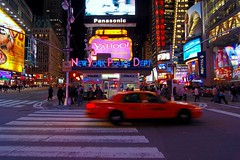 Yo, Taxi! (RMac_Photography) Tags: nyc longexposure nightphotography people newyork motion blur colors wow d50 geotagged cool nikon cityscape nightshot nypd wideangle timessquare 15mm rmac citynights