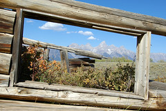 From inside the remnants of an old log structure along Gros Ventre Road, Grand Teton National Park, Wyoming, September 20, 2007 (exit78) Tags: windowframe log cabin ruin rustic grand teton national park wyoming window old house frame wood historic building sky mountains architecture grosventre mountain clouds landscape nature