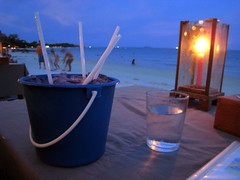 Almost every bar had bucket drinks.  We split one. (Boots in the Oven) Tags: ocean travel beach water thailand island bay bucket asia paradise candle drink alcohol lantern koh straws sexonthebeach maitai kohsamet enormous singaporesling