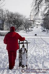 Two Sledders (kat:singer) Tags: street winter red snow photoblog sledding sled larned katsingercom