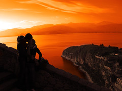Romance... (Periklis Ripis) Tags: new trip travel sunset sea vacation people orange sun mountain black mountains color love clouds landscape kiss paradise view romance greece griechenland 08 nafplio palamidi peloponnes diamondclassphotographer ripis mailciler