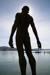Olympic man sculpture (chris.bryant) Tags: ocean sea newzealand sky people sculpture sun art sol statue standing afternoon waterfront wellington olympics 1001nights habour stood artcafe blueribbonwinner flickrsbest impressedbeauty theunforgettablepictures goldstaraward qualitypixels flickrlovers olympicman vanagram worldglobalaward globalworldawards
