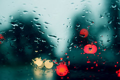 Rain Rain Go Away ... (victoria.anne) Tags: blue light red sky glass rain yellow evening spring bokeh dusk drop
