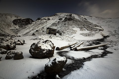 Winter Cabin (Andri Elfarsson) Tags: pictures desktop camera trip travel winter wallpaper vacation white house mountain holiday snow cold art ice apple nature rock creek canon landscape island frozen iceland high highresolution cabin rocks frost imac skiing photos timber quality fineart north fine large freezing frosty reykjavik full size memory kofi fullresolution l 40 polar northern wintersnow icelandic holyday andri 17mm mountainsnow reykjavikiceland lkur frozenice winterfrost freedesktop freewallpaper landscapephotographer superbmasterpiece 1740canon timbur elfarsson andrielfarsson skiingcabin oldskiingcabin ljosmynd canon17mm40l