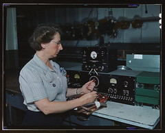Working with the electric wiring at Douglas Aircraft Company, Long Beach, Calif.  (LOC) (The Library of Congress) Tags: woman glasses october wiring stripes rosietheriveter inspection wwii slidefilm worldwarii longbeach 1940s electronics transparency ww2 4x5 lf libraryofcongress 1942 douglas largeformat inspector longbeachca worldwar2 transparencies qualitycontrol qualityassurance electricwiring historicalphotographs femaleworker xmlns:dc=httppurlorgdcelements11 douglasaircraftcompany stripedblouse womanworker october1942 dc:identifier=httphdllocgovlocpnpfsac1a35327 aircraftmanufacturing alfredtpalmer wartimeindustry electricalassembly alfredpalmer warwork skilledlabor