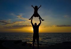Trust. (Timhaiti) Tags: ocean sea love beach water silhouette canon fun eos fly haiti jump dad daughter trust fav digitalrebel soe sillhouette throw soar thrown silouete xti golddragon 400d abigfave avision anawesomeshot theunforgettablepictures eliteimages betterthangood simplysuperb timhaiti