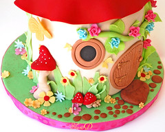 Toadstool House Cake (~Trs Chic Cupcakes by ShamsD~) Tags: house cake fairytale southafrica nikon magical whitechocolateganache enchanting whitechocolatemudcake fondantcake fondantflowers fondantroses shamsd fondantbutterflies shamimadesai fondantmushrooms fairyhousecake mushroomhousecake toadstoolhousecake cakesinpietermaritzburg