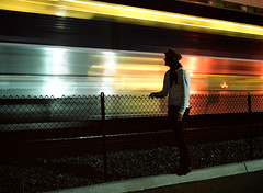 (jessyparr) Tags: california 120 mamiya hat scarf train fence rocks downtown sandiego 120film slowshutter chainlinkfence southerncalifornia rubble mamiya645 shutterspeed newsboy downtownsandiego mamiya645pro