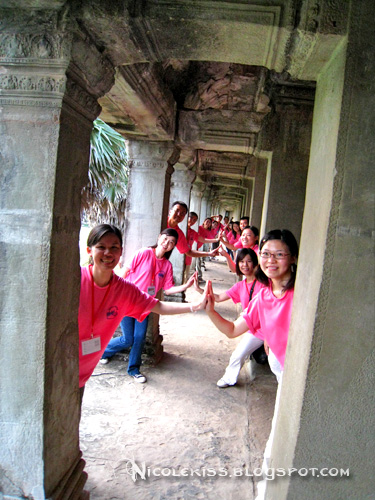 pink tour group at angkor