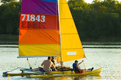 Sailing a Catamaran Busse Lake Forest Preserve Cook County Illinois (www.cemillerphotography.com) Tags: park flowers trees sunset summer plants sunlight lake chicago reflection nature water pool bike yellow forest buildings reflections landscape outdoors bicycling golden evening pier boat fishing pond rocks picnic sailing lakes scenic meadow parks officebuilding running run lookout canoe trail biking catamaran schaumburg boating land sail runners redsky geography canoeing workout overlook runner rollinghills cookcounty bucolic fishingpier boatrental goldenlight geological picnicking picnicarea cookcountyforestpreserve yellowsky northernillinois cookcountyillinois busselake northeasternillinois northeastillinois nedbrownforestpreserve forestpreserveillinois forestpreservesillinois northeasternillinoisforestpreserve northeasternillinoisparks