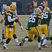 Aaron Rodgers (12), Ryan Grant (25) and Korey Hall (35)