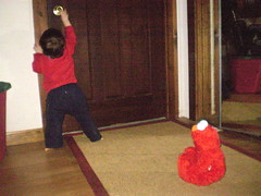 Hey Elmo, you distract the parents and I'll get the door! (momtodex2) Tags: elmo dex
