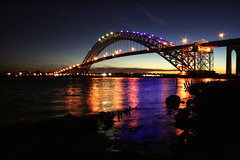 Bayonne Bridge...at its best (Manny Pabla) Tags: bayonnebridge night lights colors bay nj newjersey bayonne hudsoncounty steelarchbridge evening dark tida waterchannel us usa america killvankull statenisland ny newyork mannysinghpabla saini canon river travel dusk rocks route440 blue purple orange yellow bridge historic reflection water double landmark bloggednj northamerica