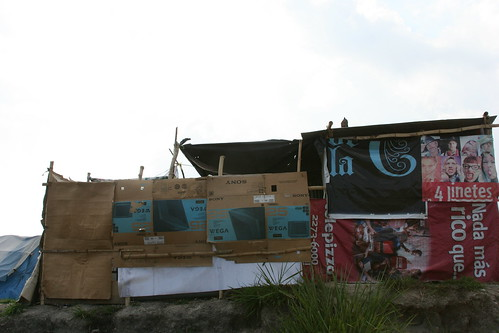 Various billboards and posters protect this structure
