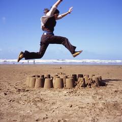 . (Rebecca...) Tags: uk anna 120 6x6 tlr film beach mediumformat square fun jump jumping fuji over slide running velvia devon 24 caughtintheact sandcastles yashica 100asa twinlensreflex saunton 100f