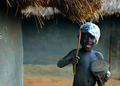 Marching to the beat of his own drum (LindsayStark) Tags: africa travel boy portrait children war child conflict uganda humanrights performers humanitarian displaced idpcamp idps idp humanitarianaid emergencyrelief idpcamps postconflict waraffected mywinners conflictaffected
