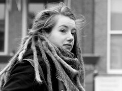 Dreadlock Anna (d_t_vos) Tags: portrait dreadlock dreadlocks woman youngwoman teen teenager girl face facesofportraits streetphotography streetportrait outside dof hair watching leeuwarden nieuwestad waagplein langepijp bw blackandwhite schwarzweiss monochrome dickvos dtvos