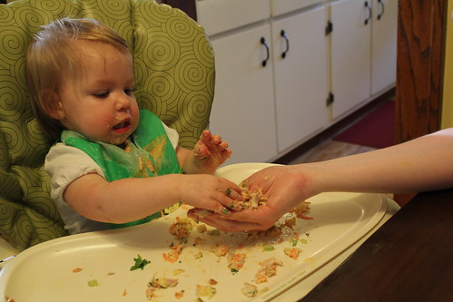 Putting the chicken salad in mom's hand