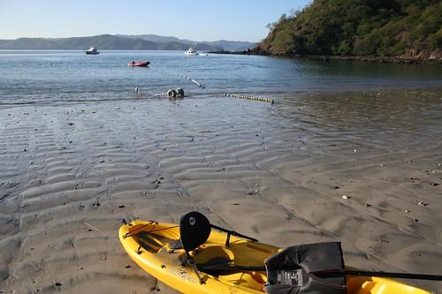 kayak, red speed boat, ocean