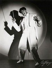 Cab Calloway - 2 (Rhythm Junkie) Tags: light portrait people musician music men wearing photography 1 outfit clothing holding suits fulllength posed jazz spotlight suit africanamericans americans blacks males prominentpersons celebrities studioshot adults zoot blackandwhitephotography cabcalloway menswear zootsuit midadult midadultman fulllengthportrait conductorsbaton iphotorating0