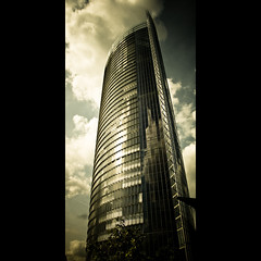 Verticals: Posttower (manganite) Tags: windows sky sun sunlight reflection tower texture topf25 glass colors sepia architecture clouds digital buildings germany geotagged construction nikon colorful europe bonn mood pattern post mail tl framed steel perspective atmosphere bluesky d200 nikkor dslr toned vignette posttower northrhinewestphalia 18200mmf3556 utatafeature manganite nikonstunninggallery challengeyou challengeyouwinner date:year=2007 geo:lat=50715238 geo:lon=7131093 date:month=september date:day=15 format:orientation=portrait format:ratio=21 stadtgetty2010