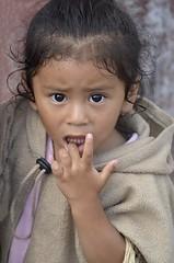 the apprehensive stare (Pejasar) Tags: girl fingerinmouth apprehensive stare portrait child antigua guatemala fingers