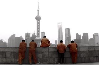 The orange workers of The Bund