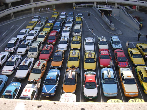 Taxis waiting at SFO to pick up passengers