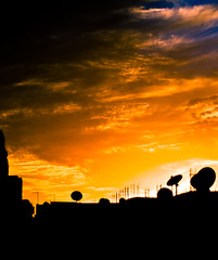 Keep on watching.... (KoRaYeM) Tags: roof sunset sky rooftop silhouette clouds digital canon buildings geotagged 350d rebel xt 50mm tv raw apartments dish egypt roofs cairo cables zayed adobe f18 sheikh digitalrebelxt giza lightroom sheikhzayed 50mmf18 photogallery gizah flickrexplore vob jiza elgiza jizah thatsclassy korayem eljizah elgizah geo:lat=3004183 geo:lon=310114 eljiza
