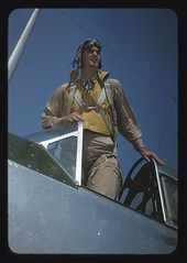 Marine Corps lieutenant studying glider piloting at Page Field, Parris Island, S.C.  (LOC) (The Library of Congress) Tags: usmc airplane aircraft aviation goggles tomcruise marines libraryofcongress marinecorps pilot topgun unitedstatesmarinecorps usmarines xmlns:dc=httppurlorgdcelements11 dc:identifier=httphdllocgovlocpnpfsac1a35121 palmeralfredt manstandingupinairplanecockpitwithyellowsh