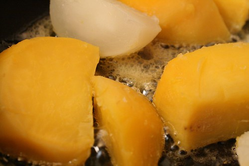 Browning the turnips and rutabaga in butter