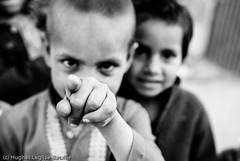 (Hughes Lglise-Bataille) Tags: pakistan blackandwhite bw topf25 kids blackwhite kid topf50 village dancing noiretblanc finger nb punjab pointing 2008 islamabad sohan