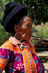 PORTRAIT OF A MIAO WOMAN (BoazImages) Tags: life china portrait flower asia dress traditional earring culture documentary daily tradition miao minority hmong indigenous pfofile boazimages