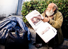 Homeless man reading the paper (OrangeCounty_Girl) Tags: street city people urban cali person la losangeles candid socal human silverlake southerncalifornia randompeople echopark westcoast ghetto humans sunsetblvd 323 lacounty californiapeople stalkerstyle