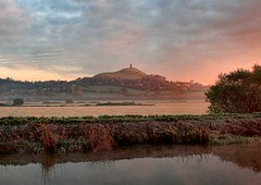 Glastonbury Tor as the Sunrises on a Misty Morning (torimages) Tags: uk morning autumn trees tree tower st misty sunrise michael frost glastonbury atmosphere somerset frosty autumncolours sd tor nationaltrust allrightsreserved somersetlevels butleighmoor donotusewithoutwrittenconsent copyrighttorimages