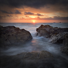 A Philosophical Snapper (jasontheaker) Tags: ocean sunset sea sun beach clouds rocks cornwall atlantic treyarnon contantine landscapephotography 11000views jasontheaker cf2007nov