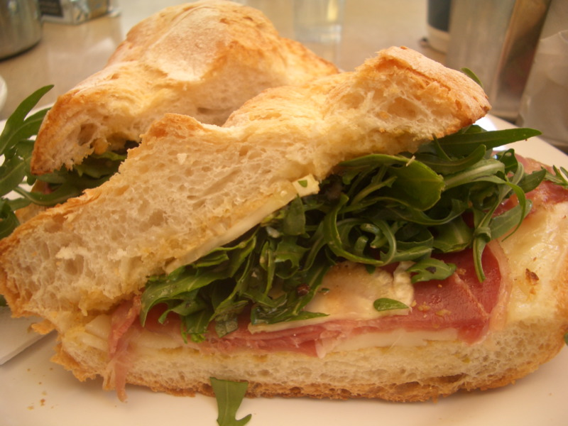 Panino with capocollo, fennel, green olive tapenade, rocket and provolone