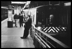 Waiting to Conduct (Nrbelex) Tags: nyc newyorkcity blackandwhite bw white newyork black film train blackwhite minolta minoltax700 grandcentralstation mta grandcentral 32 newyorknewyork conductor newyorkny metronorth grandcentralterminal x700 bw400cn harlemline nrbelex track32