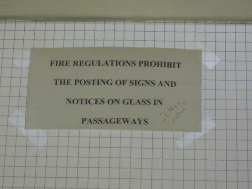 Fire regulations prohibit the posting of signs and notices on glass in passageways.
