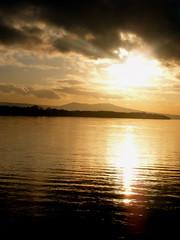 Sunset at Loch Lomond (amypalko) Tags: sunset mountains reflection sepia scotland scenery view scenic ripples loch lochlomond sunbeams