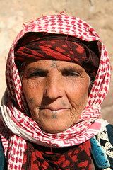 Tattoo-ed Face (hazy jenius) Tags: travel portrait people woman tattoo muslim islam middleeast hijab backpacking journey syria wrinkles bedouin euphrates deirezzur deirezzor keffeya vision deirazzur mayadin