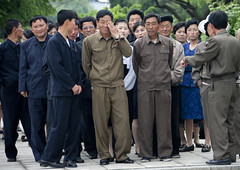 North Korean people in Juche tower (Eric Lafforgue) Tags: pictures people smile photo war asia group picture korea asie coree northkorea nk pyongyang 1927 dprk coreadelnorte northkorean nordkorea lafforgue    coredunord coreadelnord  northcorea  insidenorthkorea  rpdc  coriadonorte  kimjongun coreiadonorte