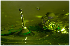 Brief moment in time... (NavindaK) Tags: motion macro green water dynamic ripple flash drop droplet top20macroinanimate highspeed trigger soundtrigger freezemotion canonef100mmf28macrousm top20green