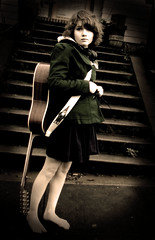 Who's that barefoot chick with headphones and a 12 string guitar? (olivia bee) Tags: girl face rain stairs hair kid gnome child guitar coat barefoot strap teenager headphones 12stringguitar descala descalza piedsnus piedinudi scalza oliviabee