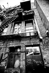 Escape (Andre Helmstetter) Tags: seattle city urban blackandwhite bw brick architecture stairs landscape alley downtown grafitti tokina fireescape