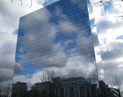 Mirrored Glass (Anne0) Tags: sky reflection clouds officebuilding reflected highrise towerblock skyreflection mirroredglass impressedbeauty flickrgolfclub canonpowershotsd950is