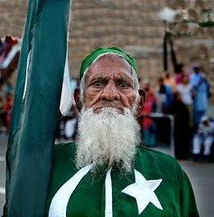 Flag carrier (Michael Foley Photography) Tags: sunset border flags soldiers lahore lowering wahgah indiapakistan babamehardin mehardin