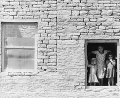 three dresses in jaisalmer (richard thomson) Tags: blackandwhite bw india 3 topf25 three nikon 35mmfilm jaisalmer rajasthan nikonfe2 fe2 50millionmissing
