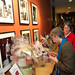 Carolyn Cronin and Laura Chase of Lawrence admiring raffle items