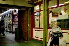 Woman Holding Bags (77krc) Tags: city england woman 35mm geotagged photo holding scanner superia markets leeds 200 epson fujifilm bags mm 35 perfection kirkgate leedscitymarkets leedsmarkets 4490 leedscitymarket leedskirkgatemarket leedskirkgatemarkets
